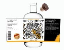 Linocut label design for deVine Spirits